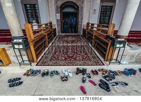 Sarajevo Bosnia and Herzegovina - August 23 2015. Shoes left by tourists in front of netry to Emperor's Mosque in Sarajevo