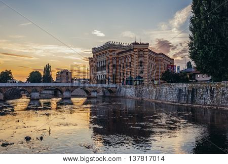 Sarajevo Bosnia and Herzegovina - August 24 2015. Sarajevo City Hall building commonly known as Vijecnica completed in 1896 lecated on the bank of Miljacka River