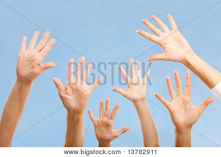 Image of hands raising isolated on blue background