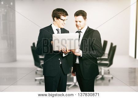 Cheerful Businessmen With Laptop