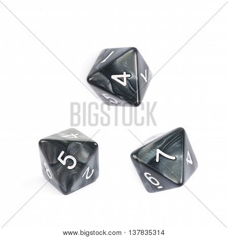 Roleplaying black polyhedral octahedron gaming plastic dice isolated over the white background, set of three different foreshortenings