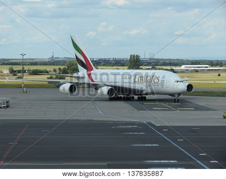 PRAGUE CZECH REPUBLIC - CIRCA JULY 2016: World biggest passenger aircraft Airbus A380 of the Emirates airlines at Vaclav Havel international airport