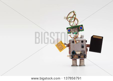 Retro style robot concept with yellow sim card and black microchip. Circuits socket toy mechanism, funny head, colored blue eyes. Copy text