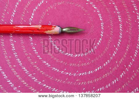 Red nib pen on pink paper textured background abstract letters pattern. macro view