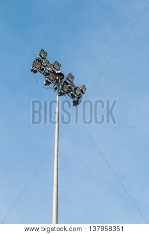 Spotlight pole with the blue sky background