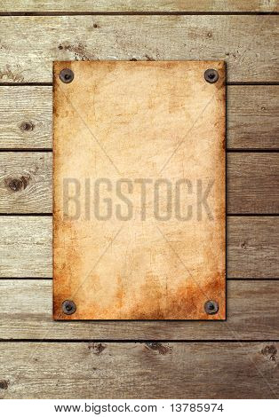Vintage Page On A Wooden Wall