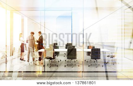 Teamwork concept. Businesspeople discussing project together in conference room interior on city background with sunlight. Double exposure