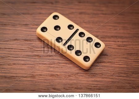 Domino six and five on the wooden table