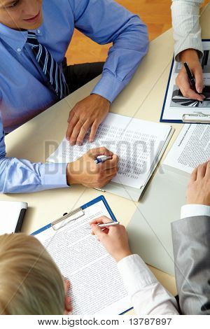 Image of business people hands during work planning at meeting