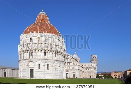 The Baptistry and the Leaning Tower in Cathedral Square in Pisa Italy