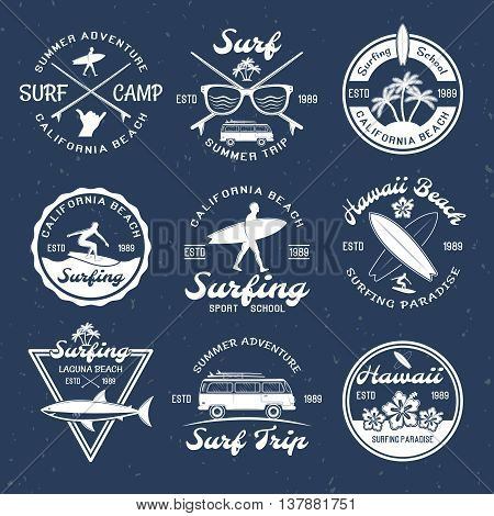 Surfing emblems on dark with descriptions of summer trip surfing school and surfing paradise vector illustration