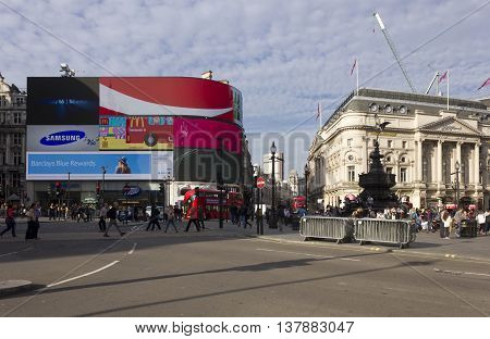LONDON, UNITED KINGDOM - SEPTEMBER 11 2015: Overview of Piccadilly Circus square at Day time with Ripley's building and famous neon signs