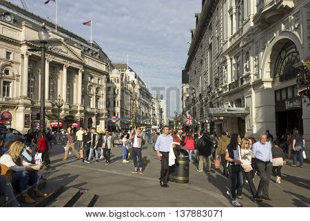 LONDON, UNITED KINGDOM - SEPTEMBER 11 2015: People walking in Piccadilly Circus in London Day time