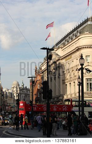 LONDON, UNITED KINGDOM - SEPTEMBER 11 2015: Piccadilly Circus Square in London with people walking along the street
