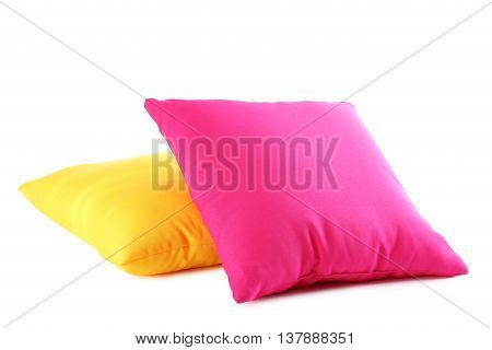 Colorful pillows isolated on a white, close up