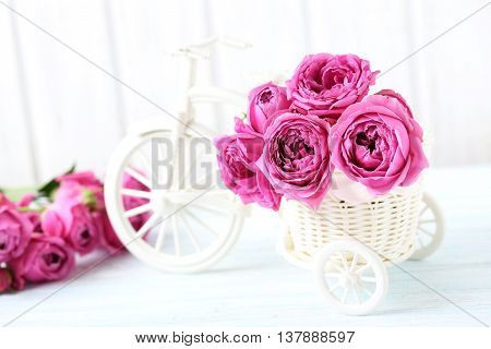 Beautiful Pink Roses On A White Wooden Table