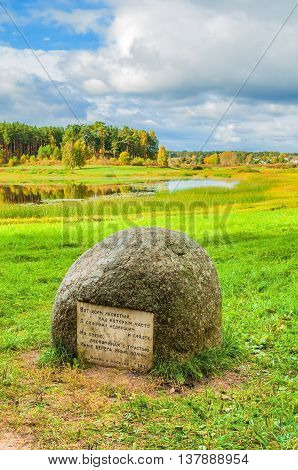 PUSHKINSKIYE GORY RUSSIA - SEPTEMBER 28 2013. Stone with poems of Pushkin at the river Soroti in museum estate Mikhailovskoe