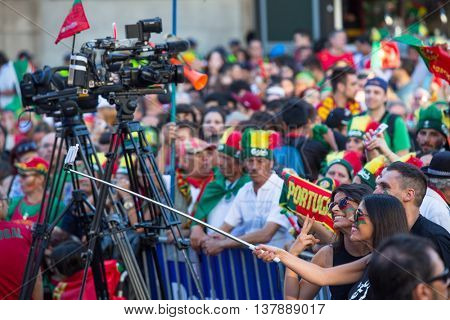 PORTO, PORTUGAL - JUL 10, 2016: Portuguese fans during video translation of the football match Portugal - France final of the European championship 2016, in Liberdade Square at city center of Porto.