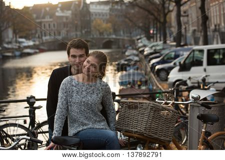 Lovers In Amsterdam At Sunset