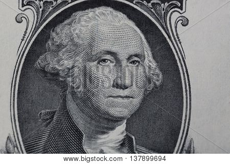 Close up to George Washington portrait on one dollar bill.