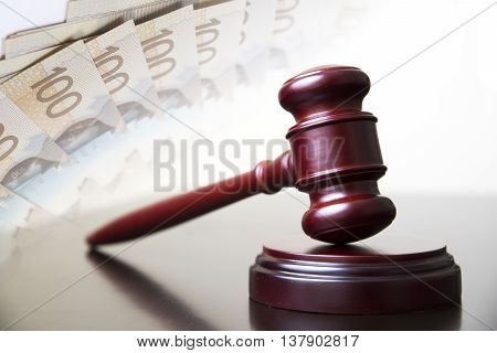 Judge gavel with money in background and corruption.