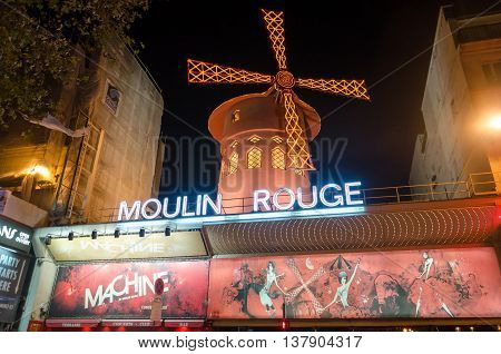 PARIS FRANCE - NOVEMBER 14 2013: The famous cabaret Moulin Rouge located close to Montmartre in the district of Pigalle on boulevard Clichy in the 18th arrondissement of Paris.
