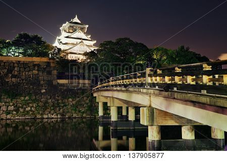 Osaka Castle at night as the famous historical landmark of the city. Japan.
