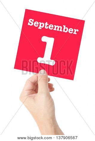 September 1 written on a card held by a hand