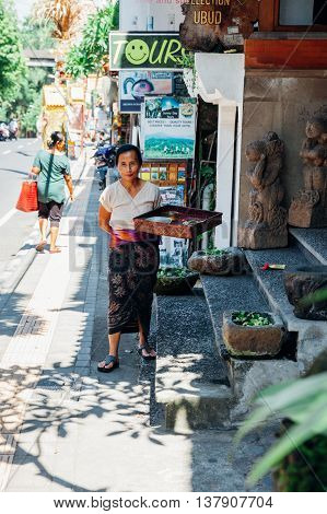 Balinese Woman Making Offerings To The Gods