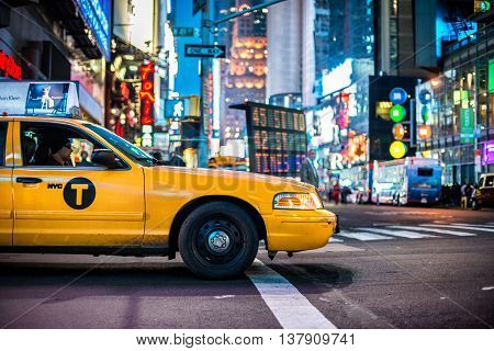NEW YORK CITY NY USA - MAY 12 2016: Yellow cabs in Manhattan NYC. The taxicabs of New York City at night Time Square.