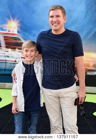 LOS ANGELES - JUL 9:  Todd Chrisley & Grayson Chrisley arrives to the
