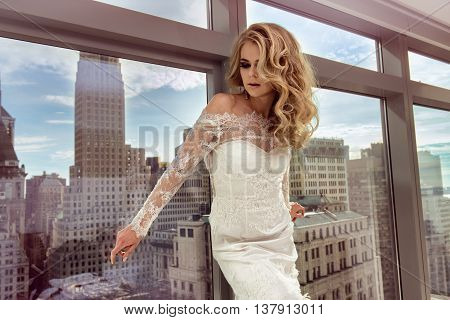 Beautiful bride posing in luxury Manhattan penthouse appartments before the wedding poster