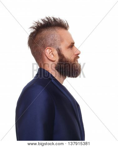Young bearded man profile isolated at white background. Close up side view portrait of guy with beard. Boy style, trendy hipster with cool hairstyle in blue suit. Modern businessman.