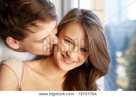 Image of man kissing his girlfriend