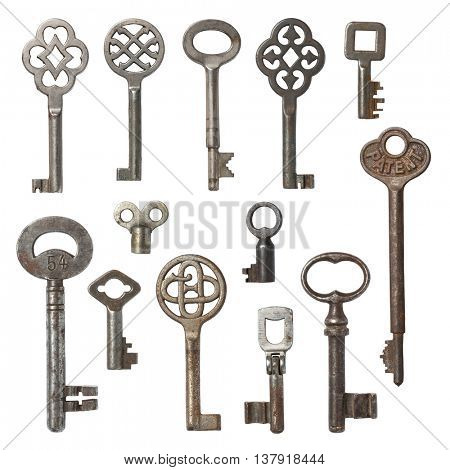 collection of vintage skeleton keys isolated on white