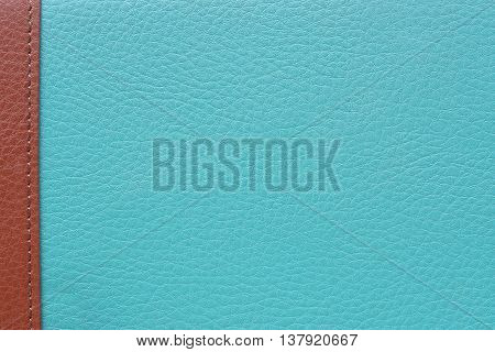 Blue leather texture with brown strip on left edge