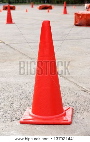 A red traffic cone for riding practice