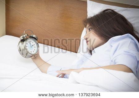Beautiful Woman Lying On Bed Sleepless At Night. Anxiety, Stress, Disease, A Common Cause Of Insomni