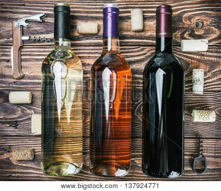 bottles of wine and various accessories on wooden table