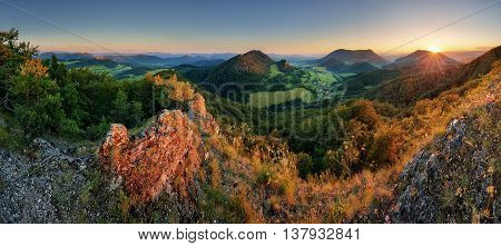 Panorama of forest mountain landscape at sunset