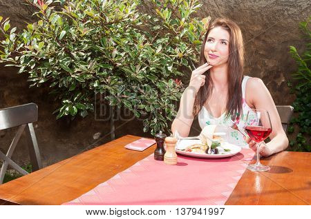 Pretty Woman Having Lunch On Terrace And Thinking