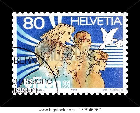SWITZERLAND - CIRCA 1991 : Cancelled postage stamp printed by Switzerland, that shows People and carrier pigeon.