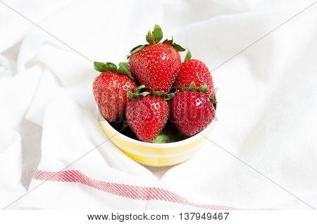 Fresh Strawberry And Juice On White Fabric. Flat Lay.