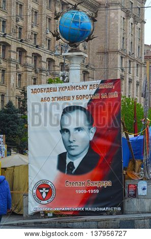 KIEV, UKRAINE - Mar 24, 2014: Stephan Bandera poster (Ukrainian nationalist icon ) near Burnt down the House of trade unions.Riot in Kiev.March 24, 2014 Kiev, Ukraine