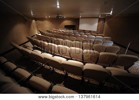 A small private movie theater cinema with seats