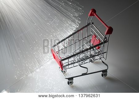 Shopping cart and Fiber optics background