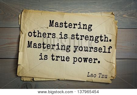 Ancient chinese philosopher Lao Tzu quote on old paper background.  Mastering others is strength. Mastering yourself is true power.
