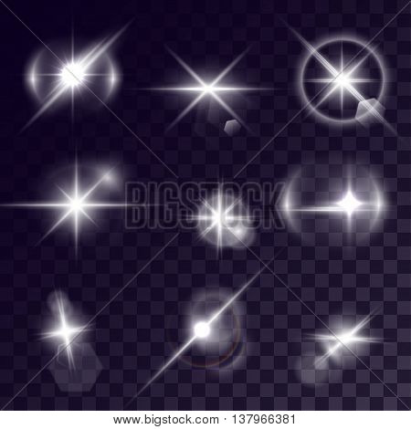 Vector starlights effects. Set of white sparks on transparent background. Release clipping mask for work.