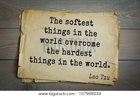 Ancient chinese philosopher Lao Tzu quote on old paper background. The softest things in the world overcome the hardest things in the world.