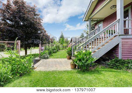 Big Farmhouse With Beautiful Flowerbed, Concrete Walkway